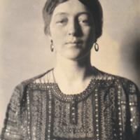 Portrait of Woman Wearing Earrings Facing Forward