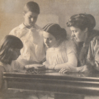Portrait of Woman and Three Children Playing Board Game