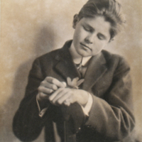 Portrait of Boy Holding Insect