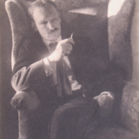 Portrait of Man Seated in Chair Holding Pipe